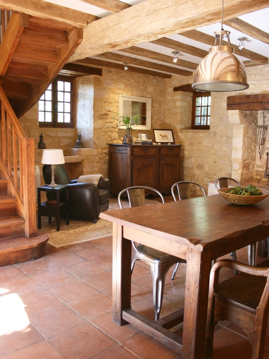 I love cozy little nooks and spaces like this. That warm spanish tile on the floor and ceiling beams are amazing.