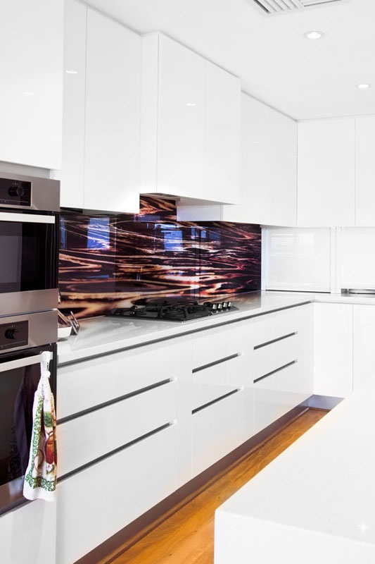 Printed glass splash back. Not this design but LOVE the idea.