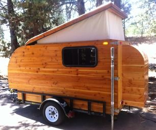 Kleine Cabine, Dutch for Little Cabin.  You are looking at a one-of-a-kind Douglas fir camper, pop top with ALL solid wood.