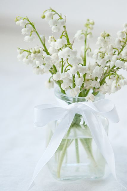 10 stems of Lily of the Valley, for DIY bulk wedding flowers (not arranged), are about $120.  Very, very premium.  This was the price Lily of the Valley last week for a Celebration of Life (August 2012). That is a BULK DIY price, not for an arrangement like above.
