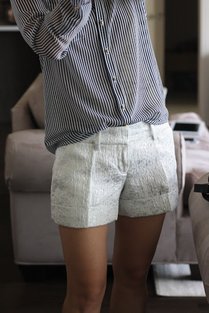Classic white shorts and striped shirt.