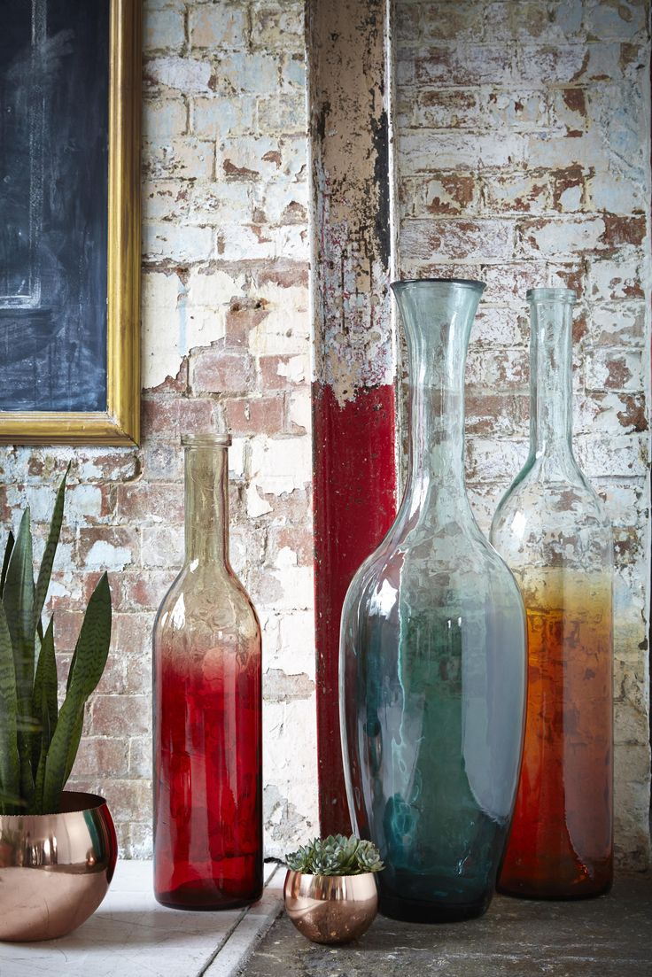 Colourful glassware arranged in a group creates an eye-catching and stylish vignette.