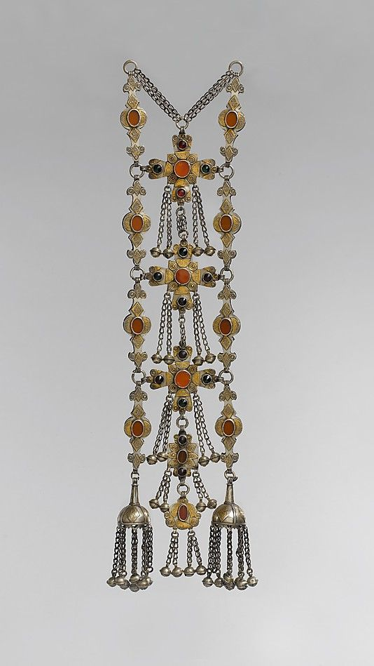 Dorsal Plait Ornament Object Name: Dorsal plait ornament Date: early to mid-20th century Geography: Central Asia or Iran Medium: Silver, fire-gilded, with applied decoration, loop-in-loop chains, semispherical bells, table-cut carnelians, and faceted glass stones