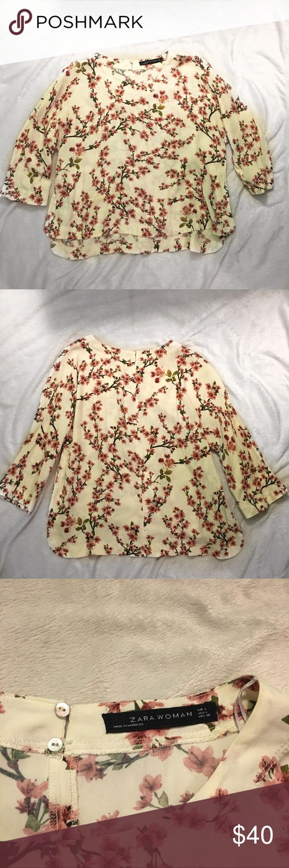 Floral Zara blouse Floral Zara blouse!! Cream top with pink flowers. In excellent condition. Has cute slits down the side. Material: 100% viscose Zara Tops Blouses