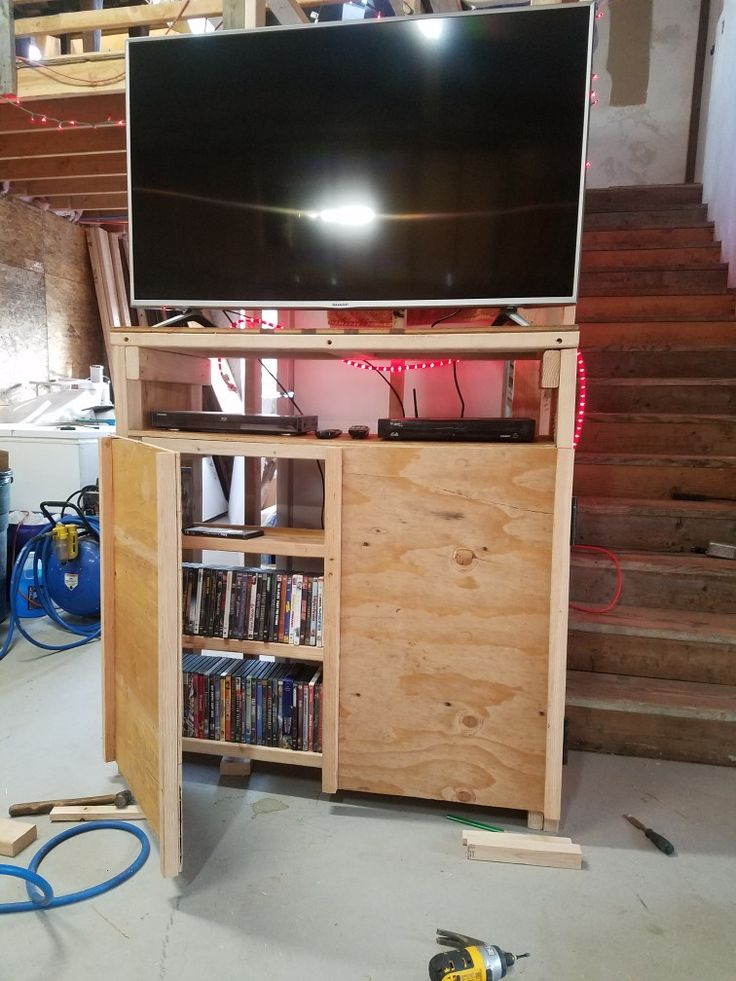 A quickie entertainment center  for our black Friday television. Made from pine 2x4 and scrap 3/8 plywood. Our Labrador 's tail won't knock dvds off!