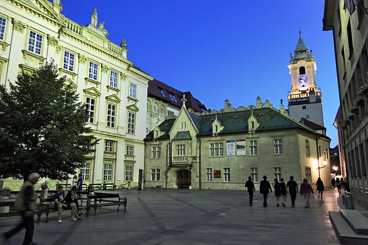 Evening descends on Primatial Square and the Town Hall, with its stately clock tower, in Bratislava, Slovakia