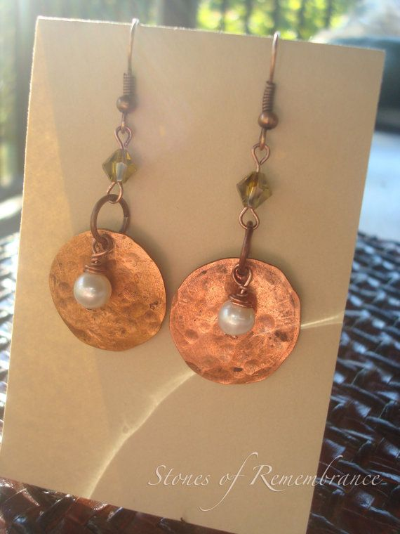 These earrings are so super cool and unique... and fresh off the press! Copper pennies hand-hammered and dented with just a little hint of