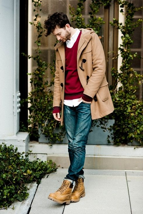 Reach for a camel duffle coat and blue jeans to create a smart casual look. Complement this polished look with tan leather boots.  Shop this look for $269:  http://lookastic.com/men/looks/longsleeve-shirt-v-neck-sweater-duffle-coat-jeans-boots/4603  — White Longsleeve Shirt  — Burgundy V-neck Sweater  — Camel Duffle Coat  — Blue Jeans  — Tan Leather Boots