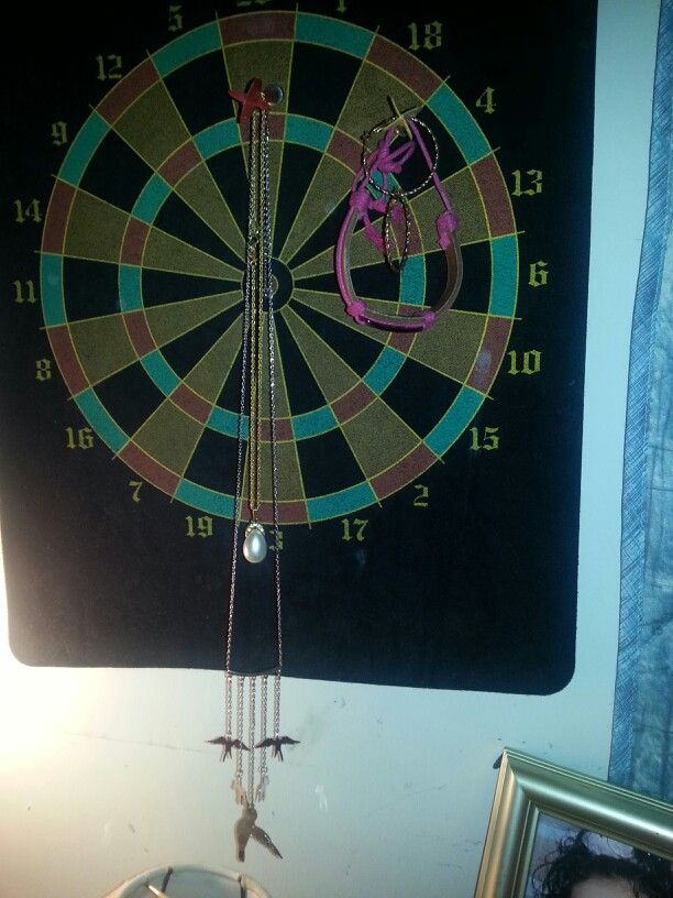 Tip: if you have a dart board w/ darts and have jewelry that you think you have no place to put, dart boards make the best jewelry holders at an affordable price