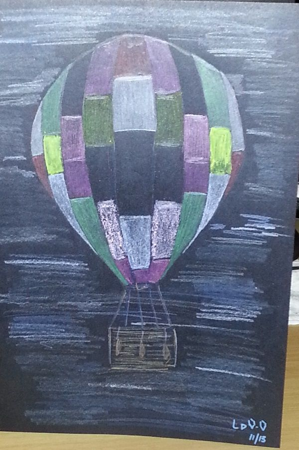 Hot air balloon done in crayon, neon pencil and metallic pencil on black background