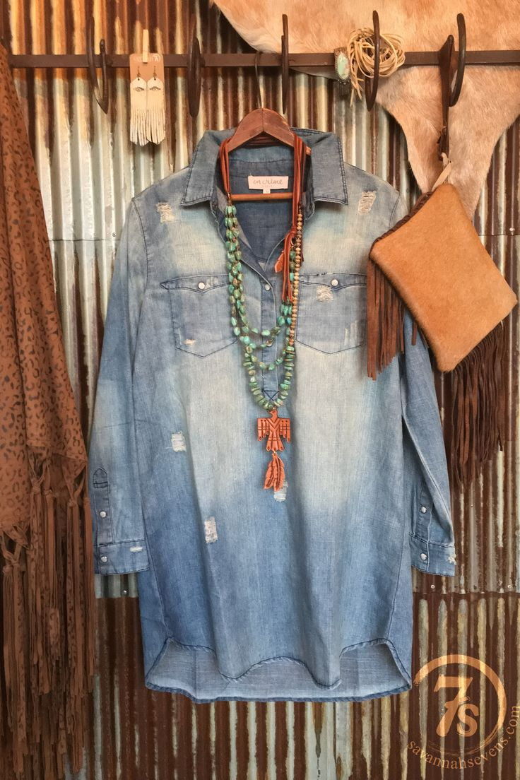 - Distressed light blue chambray denim boyfriend dress - Extreme distressed areas that give it so much unique character that we love! - Half pearl snap front - Collared - Long sleeve with snap cuffs -