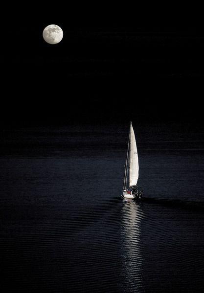 Sailing in the moonlight, Santorini island, Greece.