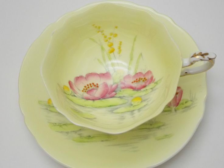 Paragon Lilies Yellow Pink Lily Pad Tea Cup and Saucer Vintage Fine Bone China Made in England by TheVintageFind1 on Etsy https://www.etsy.com/au/listing/463712836/paragon-lilies-yellow-pink-lily-pad-tea