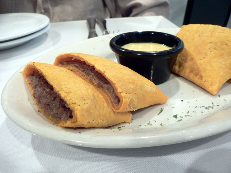 A Caribbean beef patties or Jamaican patty is a pastry that contains various fillings and spices baked inside a flaky shell, often tinted golden yellow with an egg yolk mixture or turmeric. It is made like a turnover but is more savoury. As its name suggests, it is commonly found in Jamaica, and is also eaten in other areas of the Caribbean, such as the Caribbean coast Nicaragua and Costa Rica. #food #Jamaica #spicy