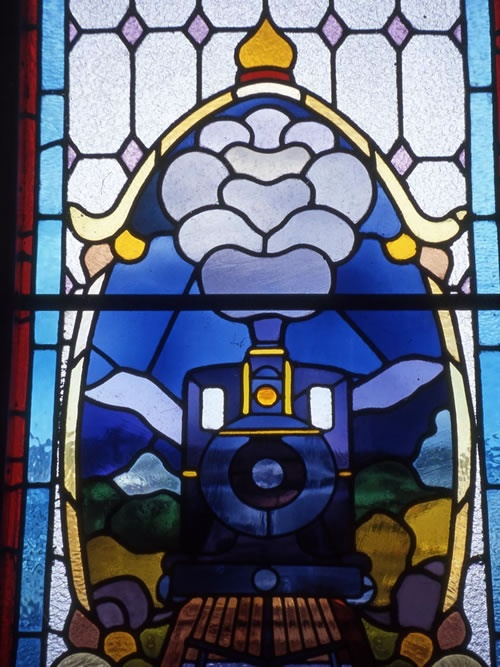 New Zealand's finest station, in Dunedin, celebrates the glory of rail in stained-glass windows.