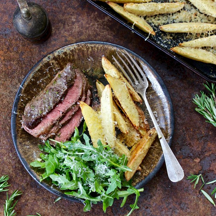 ROAST BEEF WITH PARMESAN & TRUFFLE WEDGES. We hope you are taking a seat when you read this... It might just be one of those moments you never forget! Think grass fed Angus beef dressed in garlic and rosemary, roasted to perfection. Think oven baked parmesan and truffle potato wedges. Think rocket dressed in lemon and olive oil... Think on the table in just 30 minutes! 30 Minutes. Gluten Free. Sugar Free.