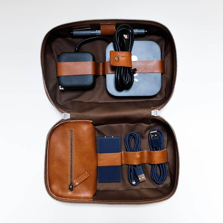 """Tech Dopp Kit 2 / regular size  toffee veg tanned leather. In this version of the """"TDK"""" we've blended a drill cotton base with leather straps and a spacious leather zip pocket. The drill cotton that we chose has a refined and soft vibe but remains durable like the leather around it. This material dates back to the mid 1800's and was commonly used in work clothing and military uniforms. So much space - with all that's stowed in this photo there's still loads of room. More to come sign up at…"""