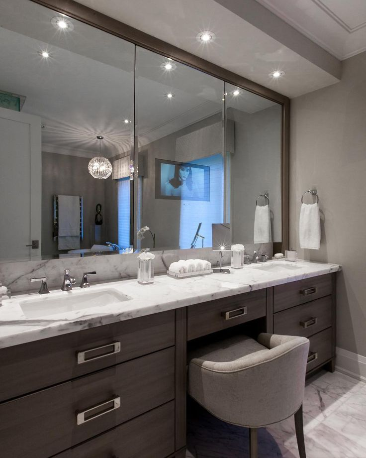 One of our custom designs for a Luxe Master Ensuite  #InteriorDesign #interior #design #designer  #bathroom #ensuite #Vanity #BathroomVanity #MakeUpVanity #CustomCabinetry #HiddenStorage #Hardware #PolishedNickel #Bespoke #WhiteMarble  #ElectricMirror #TV #AudioVideo #Technology #Automation  #luxurylifestyle #luxe #lux #ForestHill #Toronto