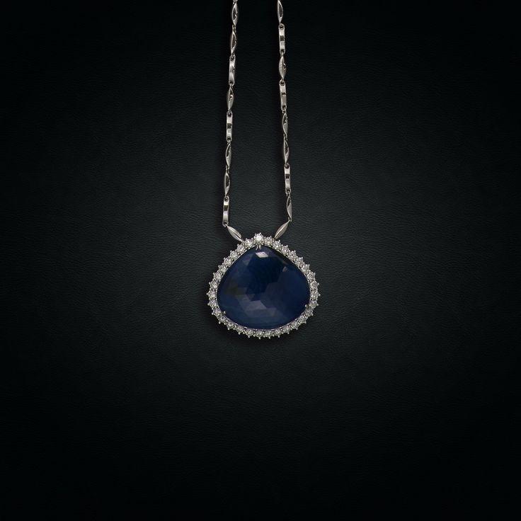 18K White Gold Pendant centering a Sapphire Drop surrounded by Brilliant-Cut Diamonds