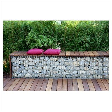 Bench made from wood and gabions backed by Fargesia murielae - Bamboo hedge - GAP Photos - Specialising in horticultural photography
