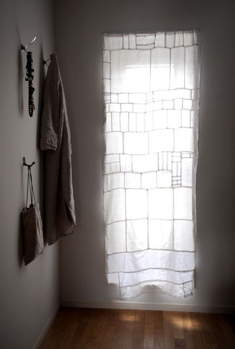 Subtle pieced together curtain; great use for old linen napkins.