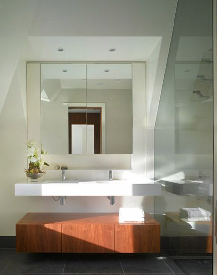 Shower and bathroom in a loft conversion. Glass walls allow the entire loft to feel like on singular space.