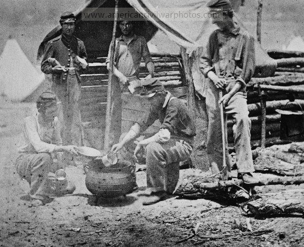 Camp of 71st New Vols. Cook house Soldiers getting dinner ready. (200 Excelsior). Date Created/Published: 1861.