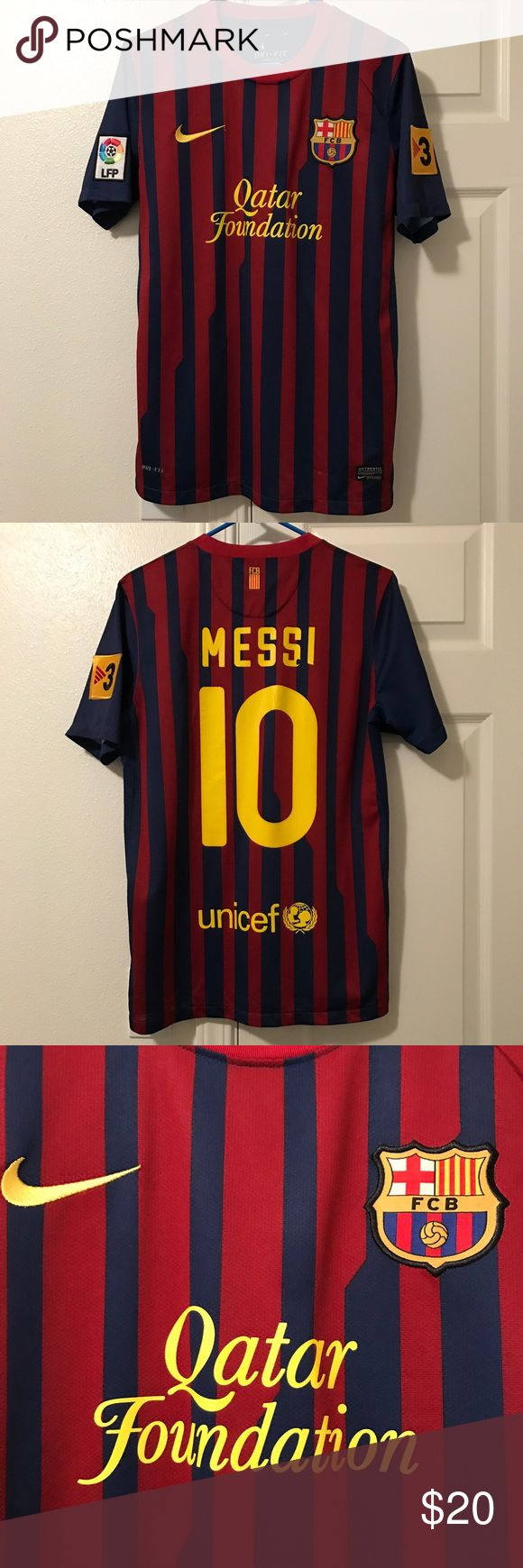 2011/2012 FC Barcelona Jersey - Lionel Messi 2011/2012 FC Barcelona - Lionel Messi Jersey. This was the first year that Qatar Foundation was front and center. The UNICEF logo is in the lower back. Must have for any FC Barcelona and Messi fan. There is some cracking and peeling on the back. Reasonable offers gladly accepted. #fcbarcelona #fcbarcelonajersey #jersey #fcb #soccerjersey #lionelmessi #messi #nike #nikejersey #messijersey #classicjersey#nikesoccer #soccer Nike Shirts