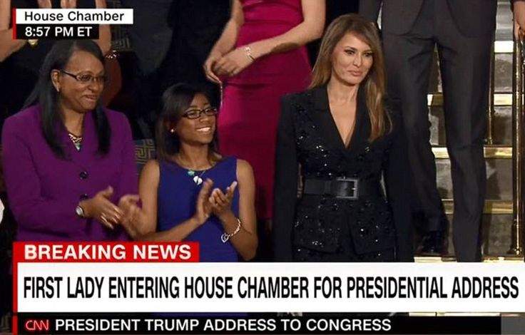 Melania was wearing a sleek, sequinned black suit, pulled together with a wide black belt,...