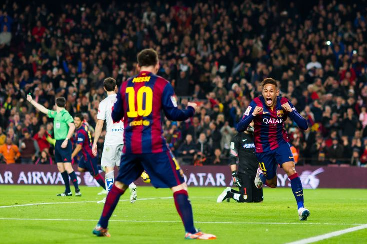 Neymar Santos Jr (R) of FC Barcelona celebrates with his team-mate Lionel Messi after scoring the opening goal during the La Liga match between FC Barcelona and Club Atletico de Madrid at Camp Nou on January 11, 2015 in Barcelona, Catalonia.