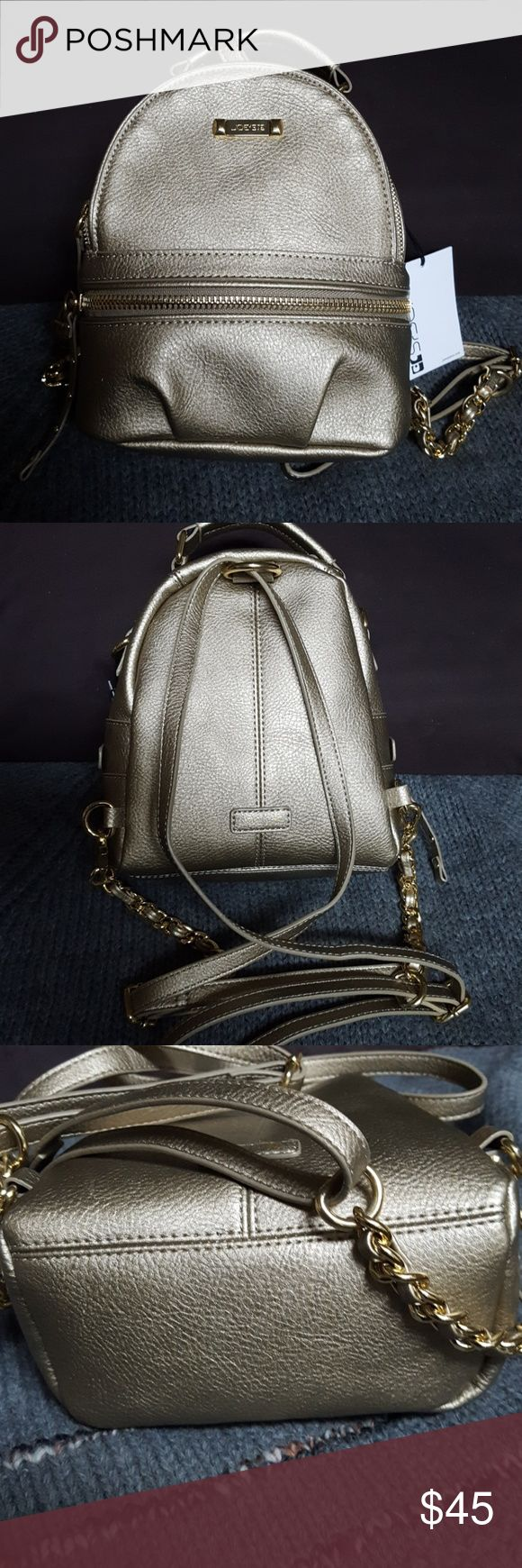 """NWT Joe's gold backpack style handbag NWT Joe's small gold backpack style handbag,  gold details with gold tone chain and leather straps. Has a front zipper pocket and inside pocket. Measures approximately 8"""" wide x 81/2"""" tall, bottom measures 7"""" X 3"""". NWT Joe's Bags Backpacks"""