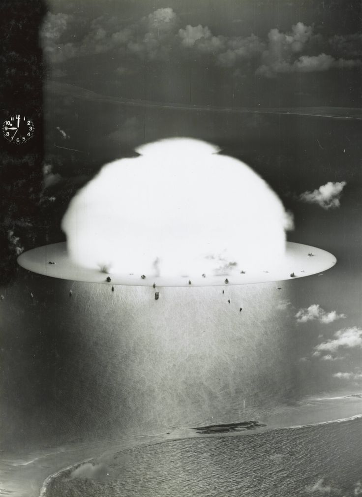 Mushroom cloud with ships evaporating below during 'Operation Crossroads' nuclear weapons test on Bikini Atoll, July 1946