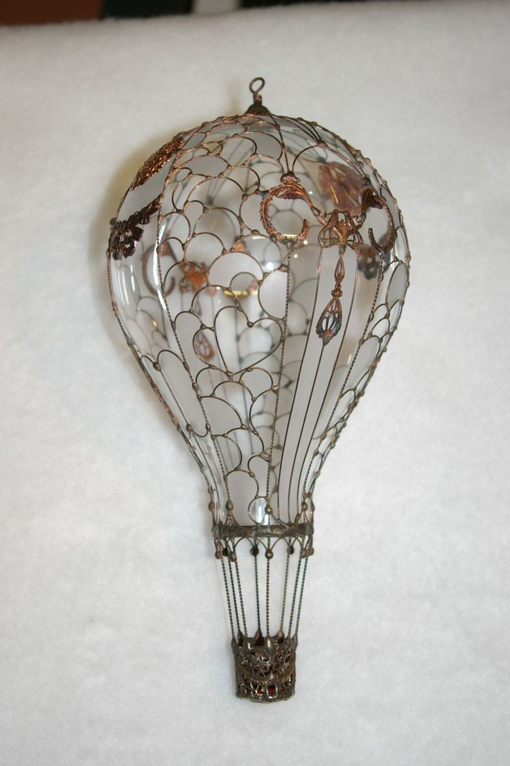 "These beautiful glass hot air balloon collectibles are made from light bulbs and enclosed with intricate copper wire patterns.  The beautiful colors are created by ""hand painting"" inside the balloon. ""Extremely"" durable."