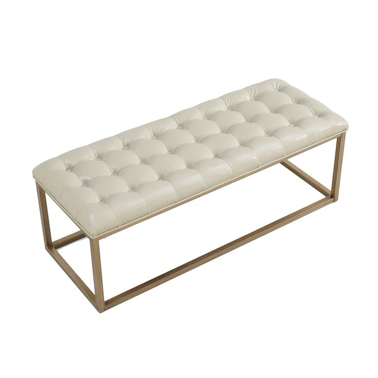 Bring a touch of Hollywood glamour to your entryway or bedroom with this gorgeous Retro Glitz bench. The cushioned top is tufted and upholstered in rich, cream-colored bonded leather, set atop a sturdy scratch-resistant brushed goldtone metal frame.