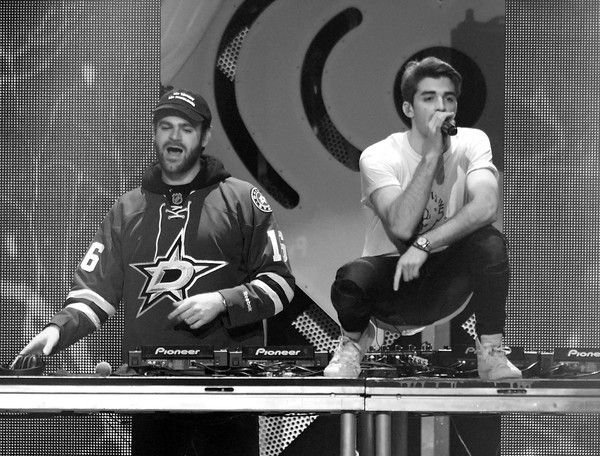 Alex Pall Photos Photos - Image has been converted to black and white.) Recording artists Alex Pall (L) and Andrew Taggart of music group The Chainsmokers perform onstage at 106.1 KISS FM's Jingle Ball 2016 presented by Capital One at American Airlines Center on November 29, 2016 in Dallas, Texas. - 106.1 KISS FM's Jingle Ball 2016 - Show