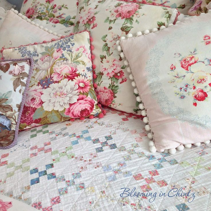 Nine Patch quilt and chintz pillows in Rahna Summerlin's bedroom. www.bloominginchintz.blogspot.com
