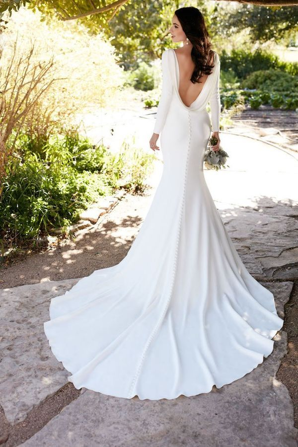 A simple and chic statement back wedding dress.