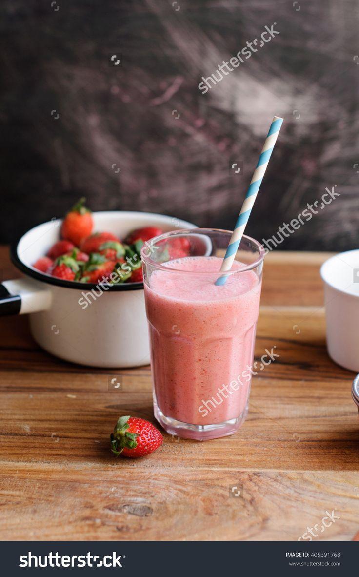 stock-photo-strawberry-milkshake-with-strawberries-in-background-405391768.jpg (996×1600)