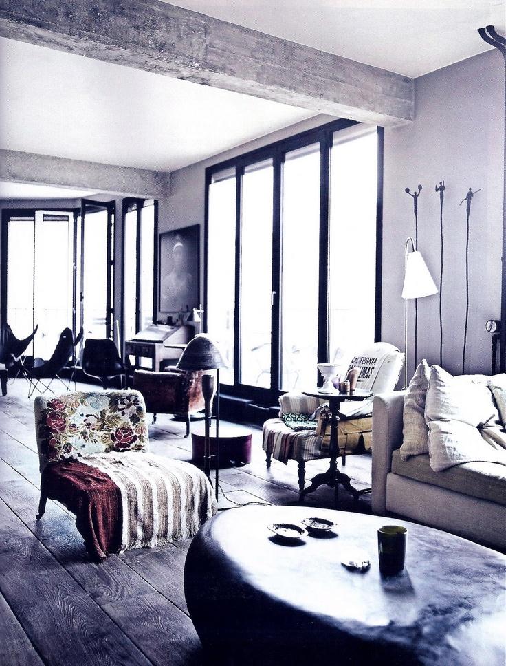 Black metal window frames in a loft apartment in Paris