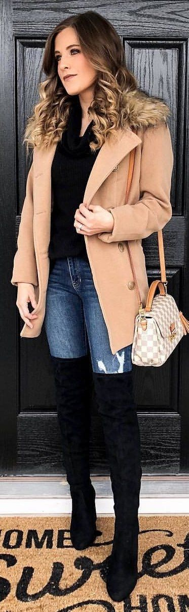 #winter #outfits beige parka coat, black top fitted blue denim jeans and black knee-high boots