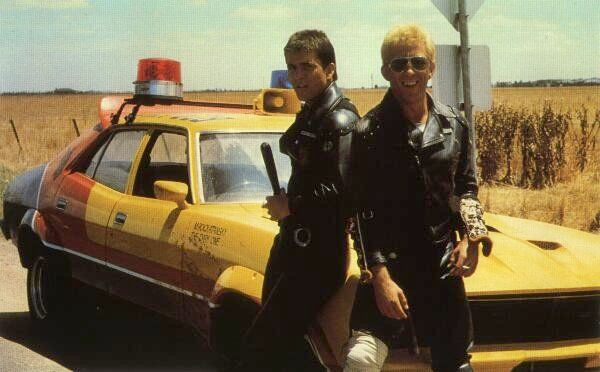 Max and Goose with Max's yellow Ford Falcon Interceptor.