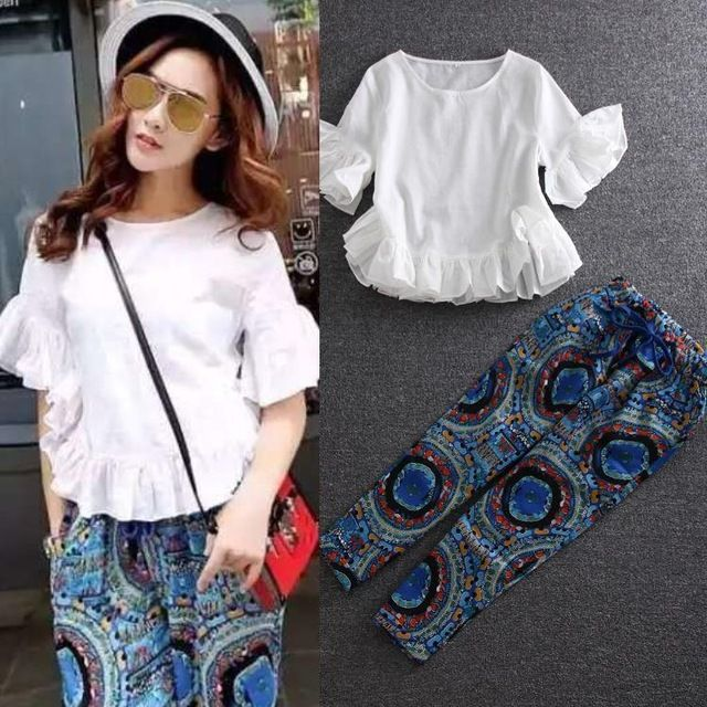 New Casual Fashion Clothes Set 2016 Spring Summer Women Ruffles White Tops Blouse+Elastic Waist Print Capri Pants(1Set)2 pcs US $59.93 Specifics Style	Casual Gender	Women Decoration	Pockets Sleeve Style	Flare Sleeve Closure Type	None Material	Cotton,Linen Pant Closure Type	Elastic Waist Collar	O-Neck Sleeve Length	Short Brand Name	None  Click to Buy :http://goo.gl/t9O329