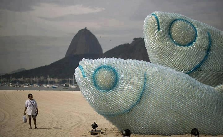 A fish sculpture constructed from discarded plastic bottles rises out of the sand at Botafogo beach in Rio de Janeiro. The city is host to the UN Conference on Sustainable Development, or Rio+20, which runs through June 22.