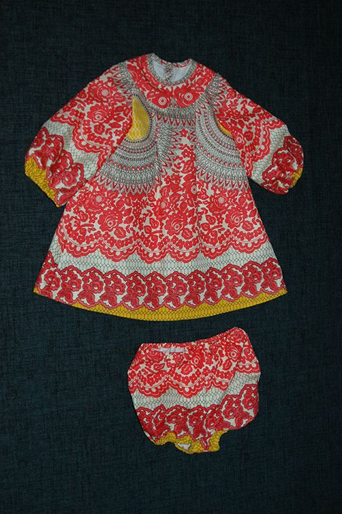 Baby girl dress with match elasticated panties in a crazy patterned fabric. The dress was lined with 100% cotton for comfort and warmth.