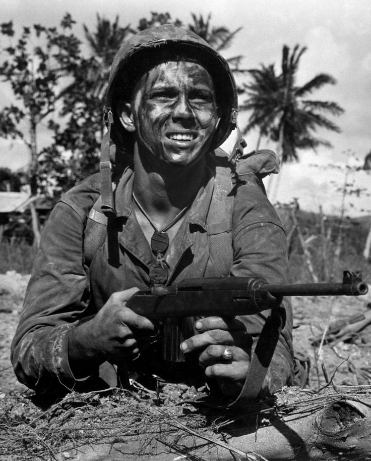 A young Marine with the M1 carbine on Guam in the Marianas, July 1944. During the Battle of Guam the US Marines lost 1,747 KIAs and 6,053 wounded. The Japanese suffered an estimated 18,000 KIAs.