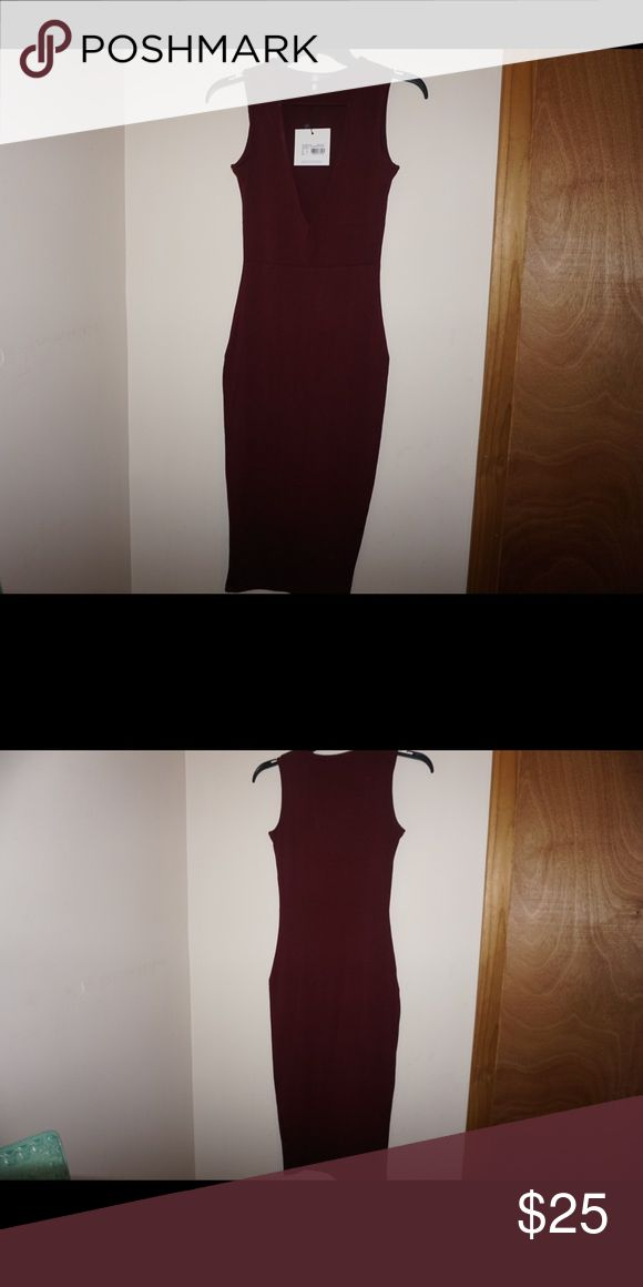 Missguided Dress Beautiful burgundy missguided dress. Plunging neckline. NWT. Missguided Dresses Midi