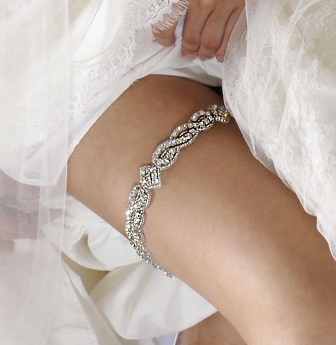 You can never have enough sparkle!  A wedding garter with crystals by Alisa Brides #wedding #garter
