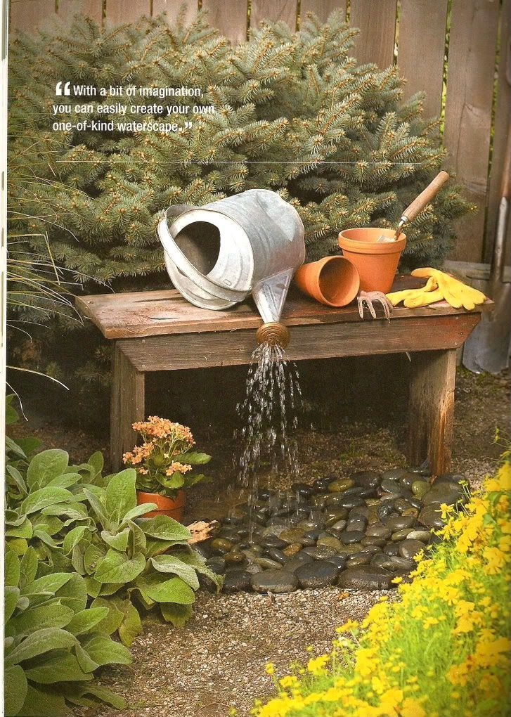 Waterscape made from an old watering can, a big bucket, a recirculating water pump, some metal mesh and decorative landscape stone