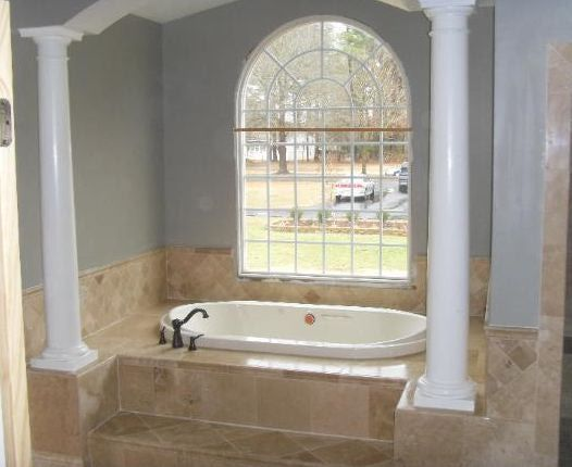 10 examples of tub surrounds tub surround bathtub for Examples of bathroom remodels
