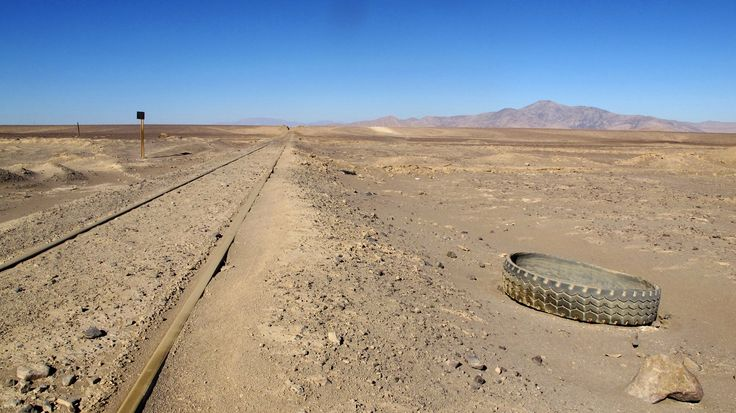 The Atacama desert in the Andes mountain range outside of Antofagasta, Chile April 15, 2013. Miners like Barrick have to go to great lengths to assure adequate supplies of water for everything from toilets for their workers to separating the valuable metals in the ore body from waste rock and tamping down dust that heavy trucks kick up. To match Feature MINING-WATER/ Picture taken April 15, 2013.   REUTERS/Julie Gordon   (CHILE - Tags: ENVIRONMENT ENERGY BUSINESS COMMODITIES) - RTX105W6